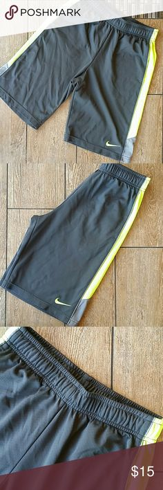 NIKE BOYS SHORTS Dark gray with  Light gray/ neon green stripe down side Elastic waist with functional drawstring Front side pockets No rips or stains or peeling of logos Smoke free home Nike Bottoms Shorts