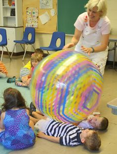 """Don't really like the song but love the idea of the activity. Great Big Ball"""" Song & Activity - cute group activity to provide some proprioceptive input. I would prefer children to be on their bellies though. Gross Motor Activities, Movement Activities, Group Activities, Circle Time Activities, Calming Activities, Leadership Activities, Physical Activities, Music Classroom, Preschool Classroom"""