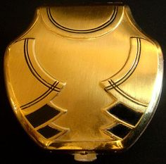 1930s triple vanity vintage compact case, with a brushed golden colour, and black enamel.