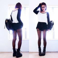 Yinyang Necklace, Crop Top, Studded Backpack, Shredded Denim Shorts, Boots