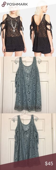 """Free People Cold Shoulder Tunic A breezy top crafted from semi-sheer embroidered cotton-blend is styled with a scalloped bateau neck, cold-shoulder cutouts with flouncy ties and a wavy hemline. 29"""" length (size Medium). 63% cotton, 37% nylon. Free People Tops Tunics"""