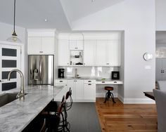 Nice Ceramic Wood Floor Tiles with Antique Stool Next to Baseboard and White Cabinets