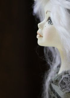 This is a handmade clay doll... gorgeous!