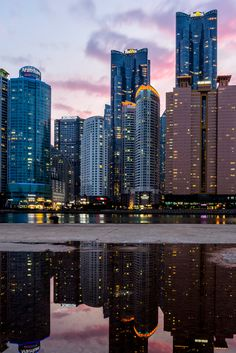 Busan photography featuring a reflection of the city skyline. While Busan is the second largest city in South Korea, it has the perfect situation on water to make it number one for photography. This picture was taken in the Haeundae District. Aesthetic Korea, City Aesthetic, Travel Aesthetic, Seoul Photography, South Korea Photography, Korean Photography, Seoul Korea Travel, Asia Travel, Korea Wallpaper