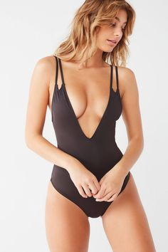 fb8fe23e79f23 Shop Out From Under Deep Plunging One-Piece Swimsuit at Urban Outfitters  today. We
