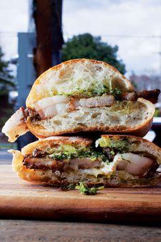 A succulent roast pork with hazelnut gremolata and lemon-caper aïoli on ciabatta buns combines beautifully to form porchetta sandwiches, like this one found at the cart Lardo in Portland, Oregon.