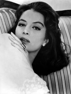 Capucine. Love the look. Capucine was a beautiful woman and talented actress. She was always troubled, she threw herself off of her apartment.