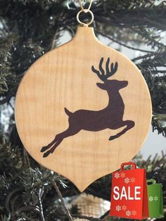 Beautiful Marquetry wood inlay Christmas ornament of Reindeer. Inlay woods are Ebony and Rosewood, background wood is quilted maple. Please note: