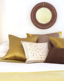 Love this idea! Pillows made out of old silk scarves. I'm not a sewer, but I think maybe even I can pull this one off!