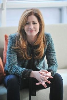 Dana Delany   I know that her hair is more brown....but i swear i see a red tint to it. and as Katherine Mayfair she was redheaded.