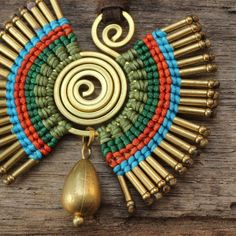 This is a fun necklace that features a series of cotton weaving around a shaped brass spiral. The necklace also features a turquoise drop that has Ammo Jewelry, Bullet Shell, Funky Design, Earring Tutorial, Brass Necklace, Micro Macrame, Cool Necklaces, Beaded Embroidery, Dangles