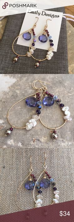 Lavender quartz cornflake pearl wire hoop earrings 14 k gold fill, hand crafted wire hoop earrings. All 14 k yellow gold filled wires, hardened and hand formed, hammered and textured. Hand crafted, filed ends and polished ear wires. Drop shaped hoops are wire wrapped.. With cranberry seed pearls, Swarovski crystals in three colors, white cornflake pearls wrapped artfully with lavender quartz drops on the top center in 12 mm size and 6 mm pyrite bead counterweight at the bottom. Earrings…
