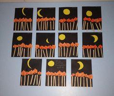 Five little pumpkins sitting on a gate ...