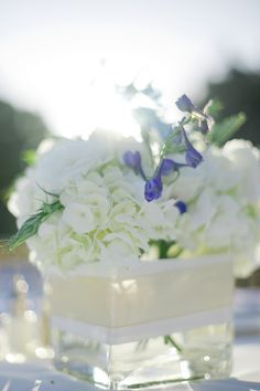 gold and whites ~ hydrangea, lisianthus and blue delphinium centerpiece