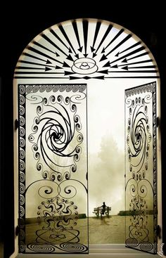 Clear door - This just made me think how cool would it be to turn your sliding glass doors into faux wrought iron gates by adding vinyl.