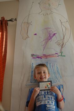 David and Goliath - giant in the classroom! Kids can color him in and then use it as our bulletin board for pictures!