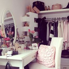 Tuck a dressing table into the walk-in-wardrobe.  (different styling to this)