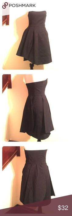 French Connection Little Black Dress Asymmetrical with tulip folds, this dress is a stunner. Side zip. With boning in the front and back to hold the structure. Size is a  UK 6, American 2. Comfortable. Made of cotton, nylon, and spandex. Length is 25 inches. French Connection Dresses