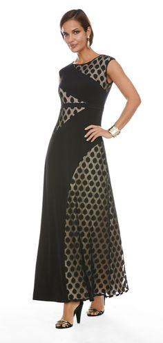 Make a date to wear this black maxi dress. Solid fabric mixes with a dot-patterned overlay for chic contrast.