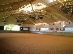 Indoor arena with ridge skylight and chandeliers