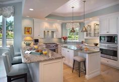 Traditional Kitchen with Kitchen island, Crown molding, Flush, U-shaped, Saman Roble Wood Plank Ceramic Tile, Subway Tile