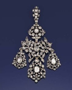 An 18th century rose-cut diamond pendant  Of girandole design, set throughout with foiled rose-cut diamonds, in a later fitted case