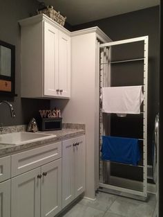 See the first ever DryAwayTM installed in a new home! This brand-new invention is cutting edge in eco-friendly laundry systems, and was designed to safely air dry clothes in order to keep them in optimal condition. These racks can be easily slid into a laundry room cabinet and can hold up to four loads of laundry at once.