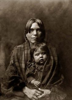 Here is an old picture of an Indian Mother and Baby. It was created in 1905 by Edward S. Curtis.