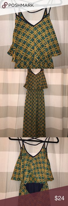 Open back Maxi dress Fun open peek a boo back maxi dress. Dress is 52 inches long and has 22 inche slit on one side of dress. Criss-cross straps on back of neck. Green and gold trendy print. Like new- excellent condition! Originally purchased from Lord & Taylor sugarlips Dresses Maxi