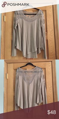 Free people lace thermal This shirt has gorgeous lace at the top that continues into the back, it is very comfortable and has only been worn once! It is a taupe color! Free People Tops