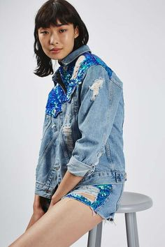 The denim jacket gets even cooler with this oversized style. Crafted from pure cotton in an edgy bleach wash, it comes detailed with a pretty sequin panelling to the shoulder and chest with a button down front and abrasions. #Topshop