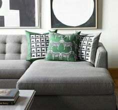 gray couch with green accessories.. Great idea instead of using red!