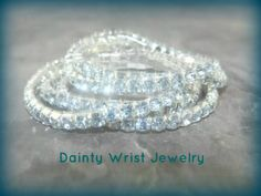 NEW ARRIVAL! Set of five diamond rhinestone bracelets made exclusively for women with skinny wrists! They are only $16.00, and free shipping! Get them now at http://www.daintywristjewelry.com/Shimmer-Bracelet…/0146.htm