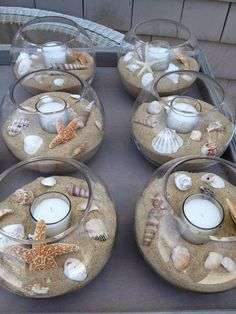 DIY beach themed Wedding Table Center Pieces - seashells, sand, tea light candles, glass bowls -- these would also look beautiful on a covered patio, or an end table. Description from pinterest.com. I searched for this on bing.com/images #beach_decor_table