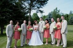 The tan suits and melon pink dresses worked perfectly together for this July wedding.  Landi wedding, photo by Rita Ann Maloney.