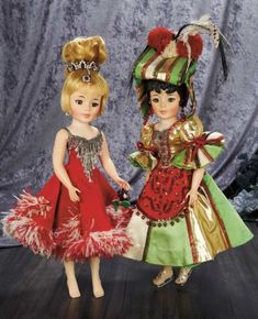 """Jacqueline in Ice Capades Costume with Elaborate Coiffure,c. 1961 21"""" (53 cm.) Vinyl socket head,brown sleep eyes,lashes,blue eye shadow,pink lips,ash-blonde hair arranged in bobbed fashion around the face and captured in a very high exaggerated pouf of curls at her crown,captured by a ringlet crown in faux-rubies and diamonds,seven-piece adult-lady-shaped body. She is wearing a bright red costume with v-shaped bodice panel of rhinestone and dangling prismatic tear-drops,red and white…"""