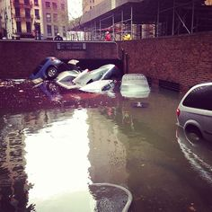 """Cars submerged at 80 Broad Street in NYC. """"Frankenstorm"""" Oct. 2012"""