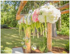 Large arbor piece.  Hydrangea, roses, thistle, and wax flower. Pink Blue and White Flowers. Includes hanging globes.