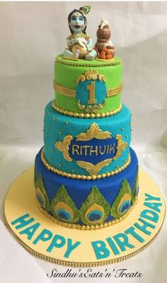 A first birthday cake with the theme of baby krishna eating butter and the peacock feathers in combination of peacock shades Boys 1st Birthday Party Ideas, 1st Birthday Dresses, First Birthday Party Decorations, Baby Boy First Birthday, Baby Birthday Cakes, Baby Boy Cakes, Baby Shower Cakes, Krishna Birthday, Indian Wedding Cakes