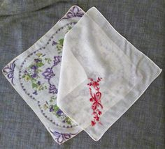 This lovely set of 2 vintage handkerchiefs was created during the late 1940s/early 1950s. One is creamy white with embroidery in shades of