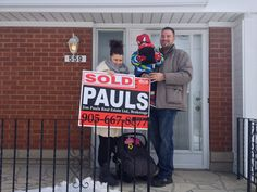 Anthony and Deborah standing in front of their new home!!