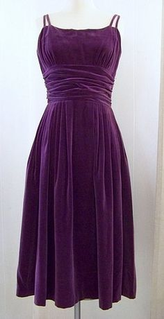 Purple velvet dress.