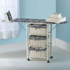 The versatile Ironing Center keeps an ironing board artfully hidden but ready to use.