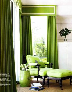 Gorgeous lime green floor to ceiling curtains with matching arm chair, ottoman and glossy Chinoiserie-inspired garden stool side table.