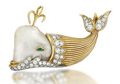A PEARL AND DIAMOND NOVELTY BROOCH Modelled as a whale, the blister pearl head with emerald single-stone eye, to the reeded body and pavé-set brilliant-cut diamond tail, circa 1960.