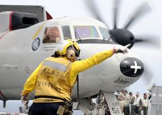 Directing an E-2C Hawkeye by US Navy, via Flickr