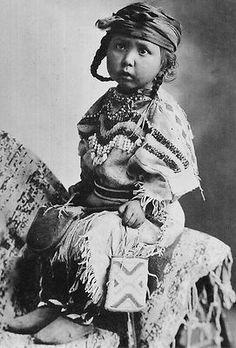 Unidentified little girl wearing a Blackfoot dress