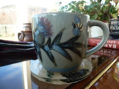 One of the beautiful Thistle mugs from the Highland Pottery in Lochinver. We only use Highland Pottery at Ruddyglow Park... from Aga to table to dishwasher (and deep freeze if there is anything left) - It's fantastic.