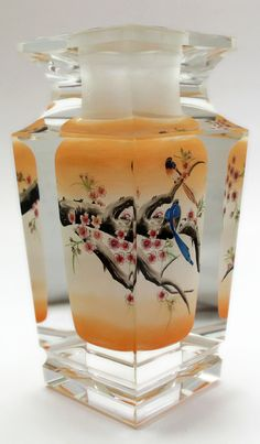 Reverse painting of two parakeets sitting on a tree branch. This crystal vase glass art work was 100% painted on the inside of the bottle.  www.lucidrealmcollection.com