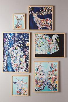 loving on this colorful gallery wall of cute creatures - so fun for a kids room without being too babyish